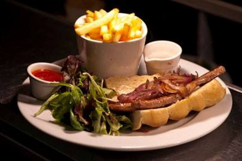 6oz Steak Sandwich on Grilled Ciabatta with Sauté Onion, Pepper Sauce, Horseradish  Dressing and French Fries