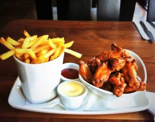 Chicken Wings and Chips on a plate with mayo