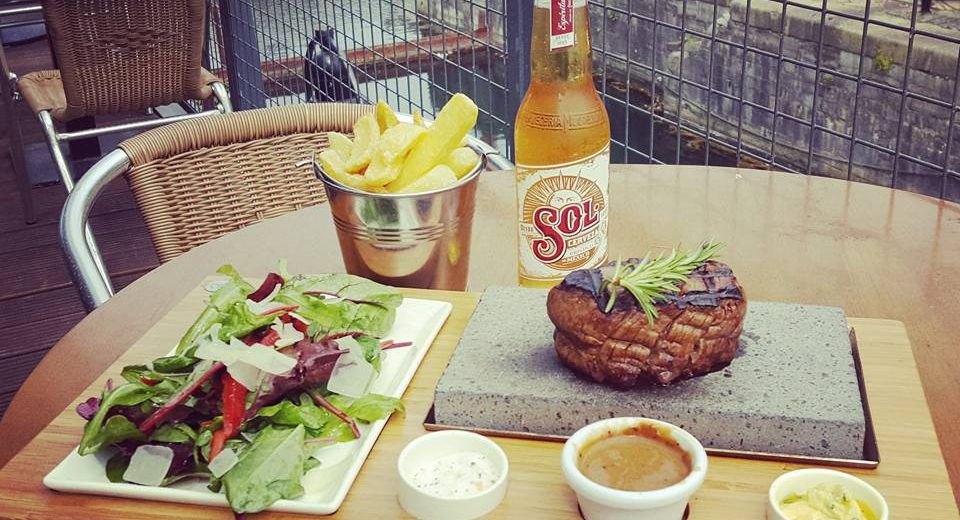 Sizzling Steak on a Stone with Chunky Handcut Chips & Peppered Sauce, Ballymaloe Relish & Garlic Butter