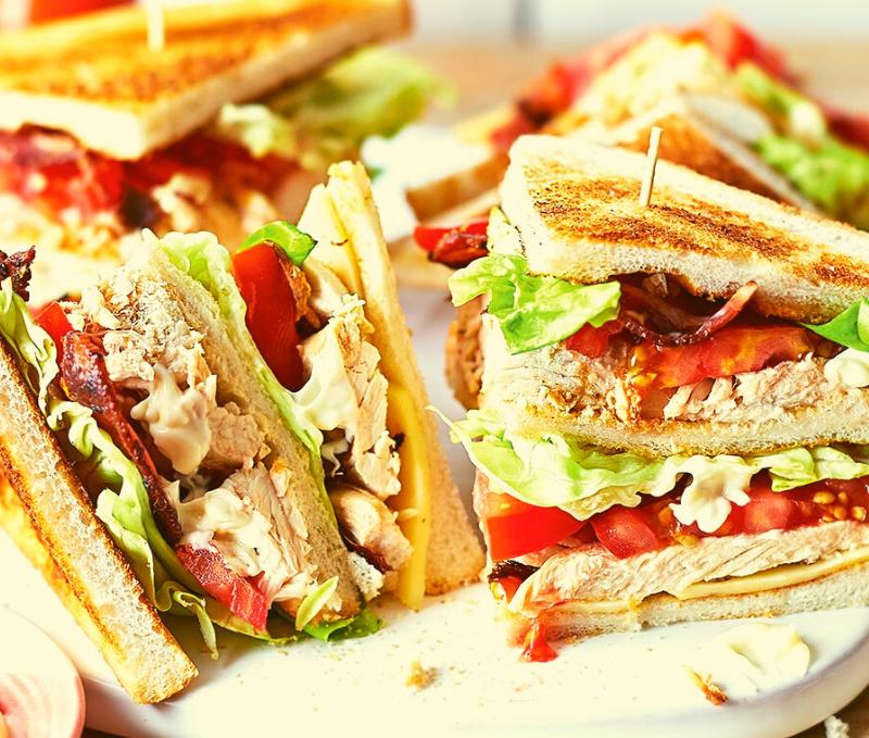 Avocado and Egg Club Sandwich, Lettuce, Tomato, Red Cheddar and Garlic Aioli